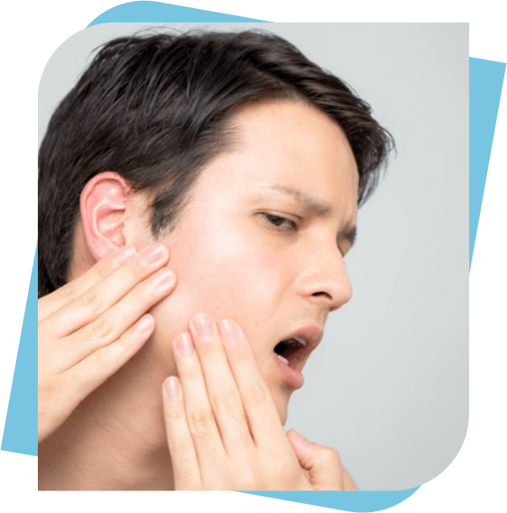 Man massaging his jaw to relieve pain.